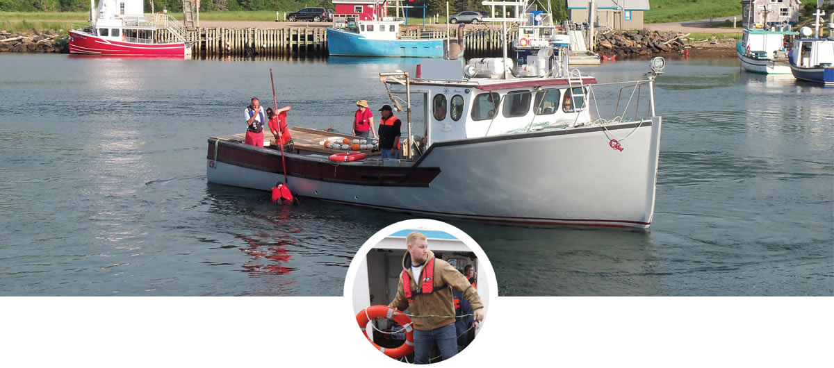 Nova Scotia fishermen undergoing safety training: assisting an overboard fisherman get back into the boat.